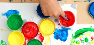brightly colored pots of finger paints