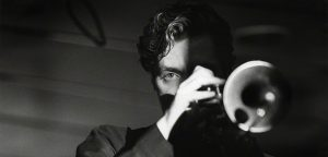 Chris Botti playing trumpet in black and white jazz photography