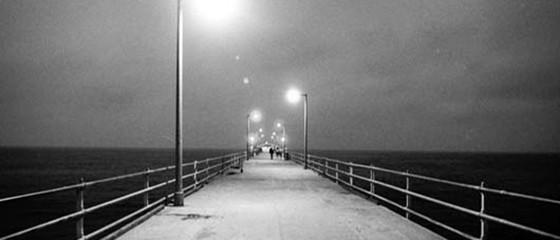 Image from 1989 film, La jetée showing pier extending towards horizon
