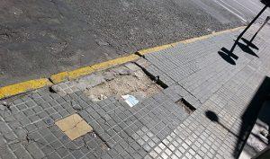 City sidewalk with broken sections, Montevideo, Uruguay