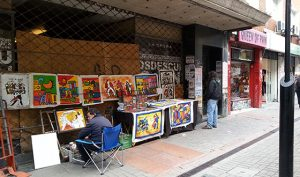 street vendor with his paintings, Montevideo, Uruguay